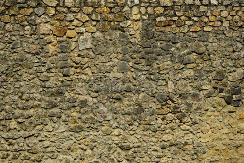 Viejo cierre de Brasov Rumania de la textura de la pared del ladrillo y de piedras para arriba de la textura del fondo de la pare fotos de archivo