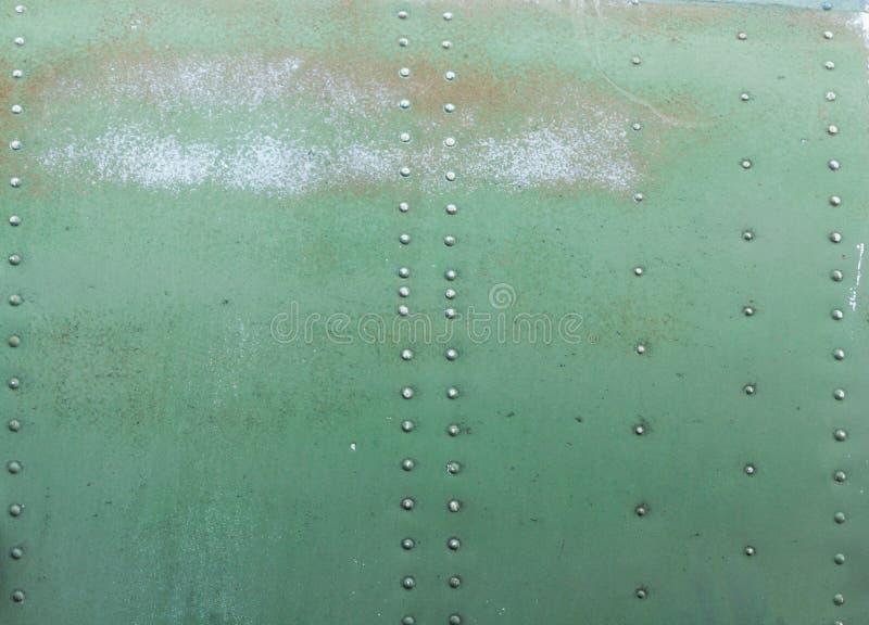 Viejo detalle pintado de un avión militar, corrosión superficial del fondo del metal imagen de archivo libre de regalías