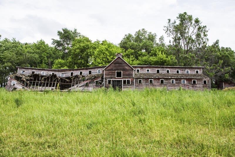 Viejo estable del milkhouse de la librea del granero de la granja fotos de archivo libres de regalías