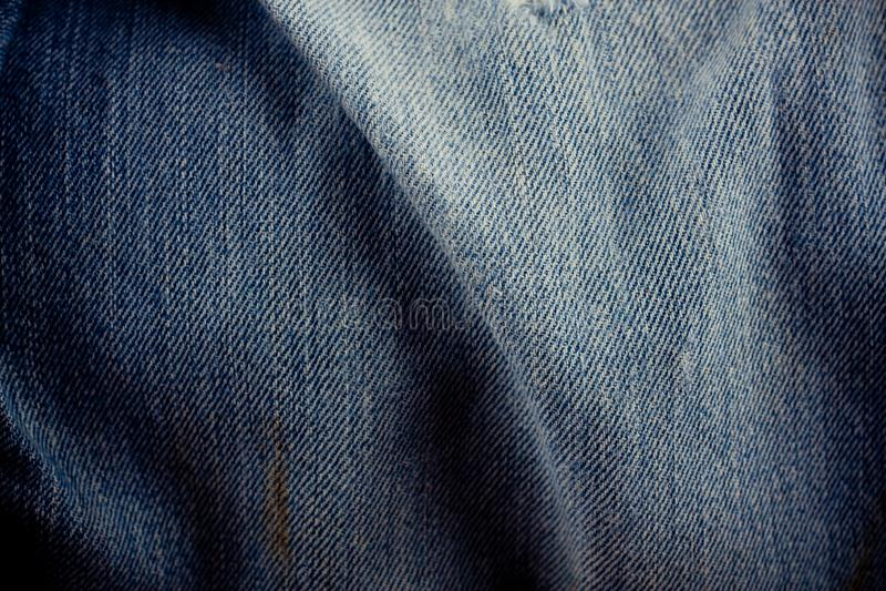Viejo fondo azul marino de los vaqueros del dril de algodón de la textura de los vaqueros del dril de algodón de la textura de lo imágenes de archivo libres de regalías