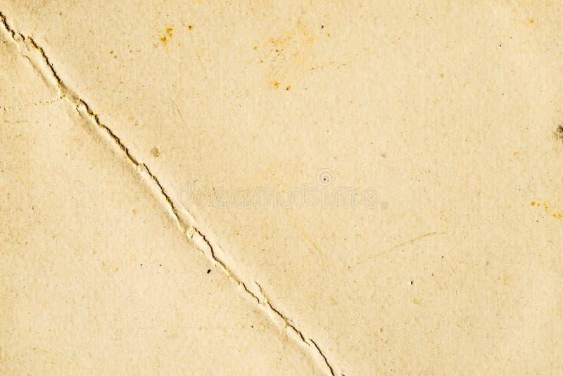 Viejo fondo de papel con la grieta imágenes de archivo libres de regalías