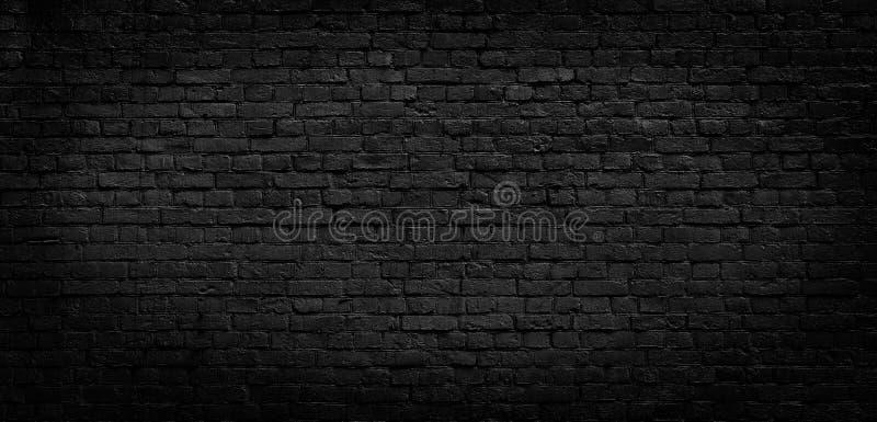 Viejo fondo negro de la pared de ladrillo imágenes de archivo libres de regalías