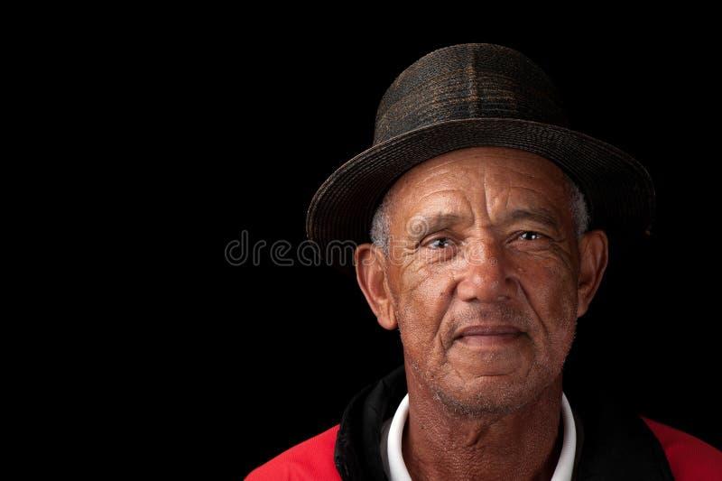 Viejo hombre con el sombrero imágenes de archivo libres de regalías