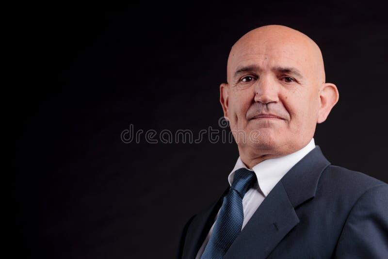 Viejo hombre de negocios calvo imagen de archivo libre de regalías