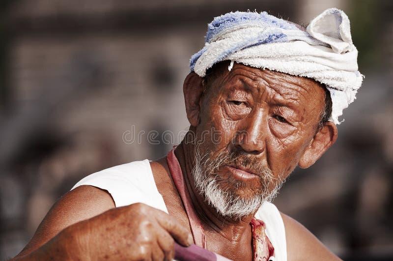 Viejo hombre en China occidental imagenes de archivo