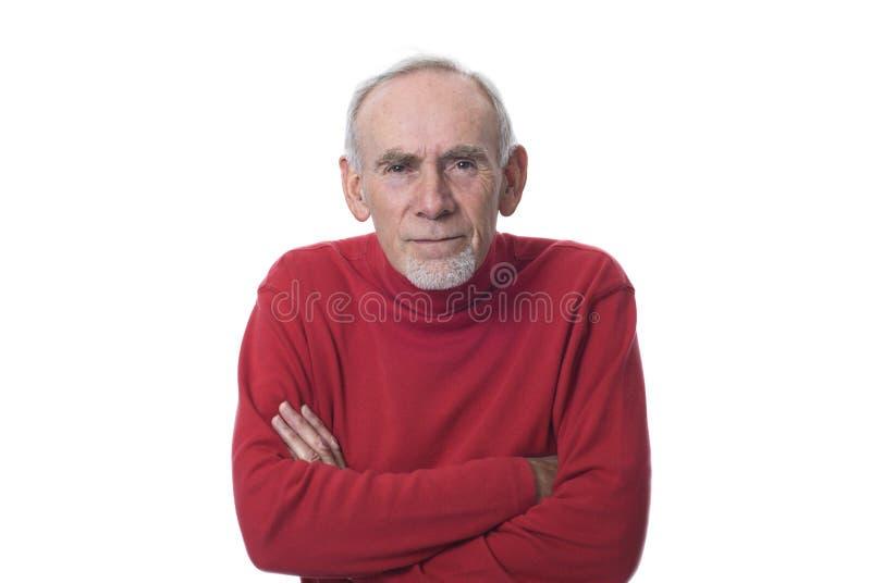 Viejo hombre que mira con fijeza y que frunce el ceño imágenes de archivo libres de regalías
