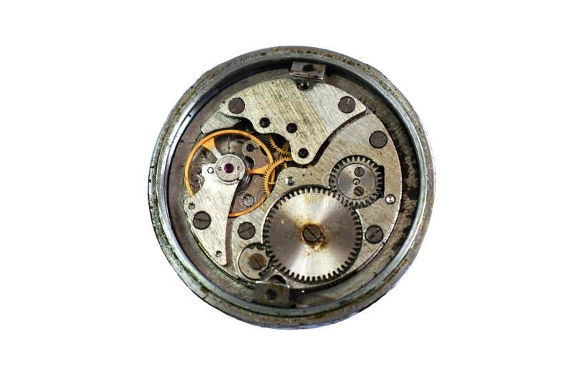 Viejo mecanismo del reloj del vintage Suciedad oxidada del aceite en los engranajes del círculo antes de limpiar y del refinamien fotos de archivo libres de regalías