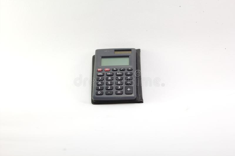 Viejo sistema de iluminación portátil de la calculadora en el Blackground blanco fotos de archivo