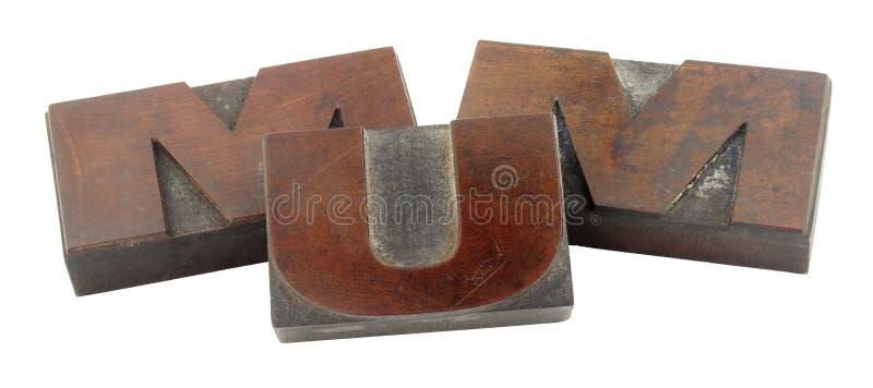 Viejos bloques de impresión de madera que deletrean a la MOMIA fotos de archivo