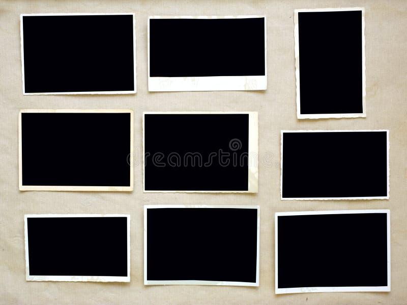Viejos marcos vacíos de la foto, impresiones sucias de la foto en fondo sucio con el espacio libre del pix imágenes de archivo libres de regalías