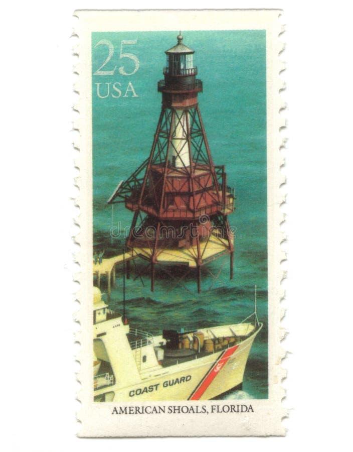 Viejos sellos de los E.E.U.U. con el faro fotografía de archivo libre de regalías