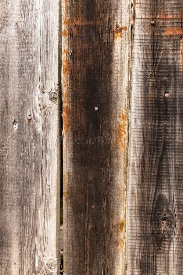 Viejos tableros de madera con textura de los clavos del hierro fotos de archivo
