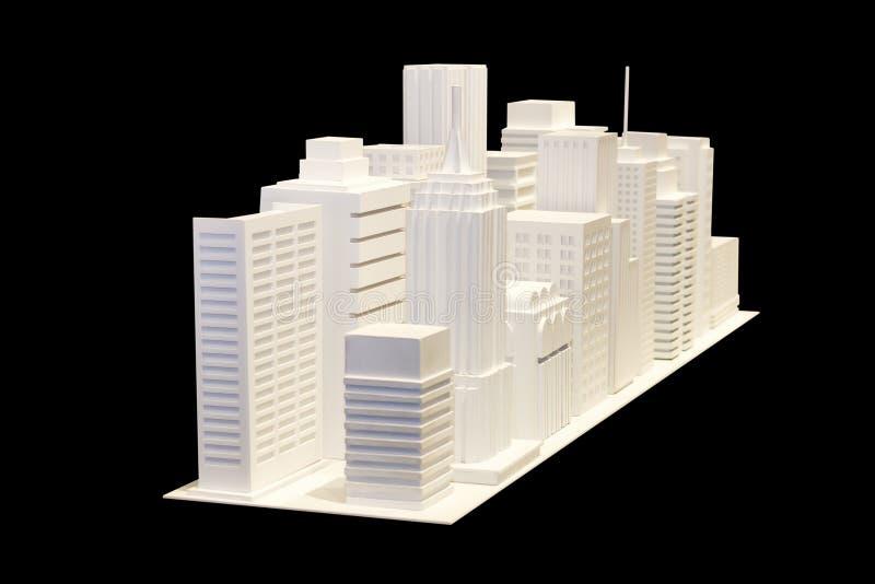 Viel weißes errichtendes Modell lokalisiert auf schwarzem Hintergrund lizenzfreie stockfotos
