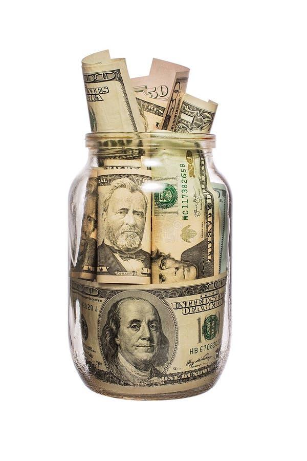 Viele Dollar in einem Glasgefäß lokalisiert auf Weiß stockbild