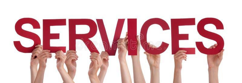 Viele Leute-Hände halten rote gerade Wort-Dienstleistungen lizenzfreie stockfotos