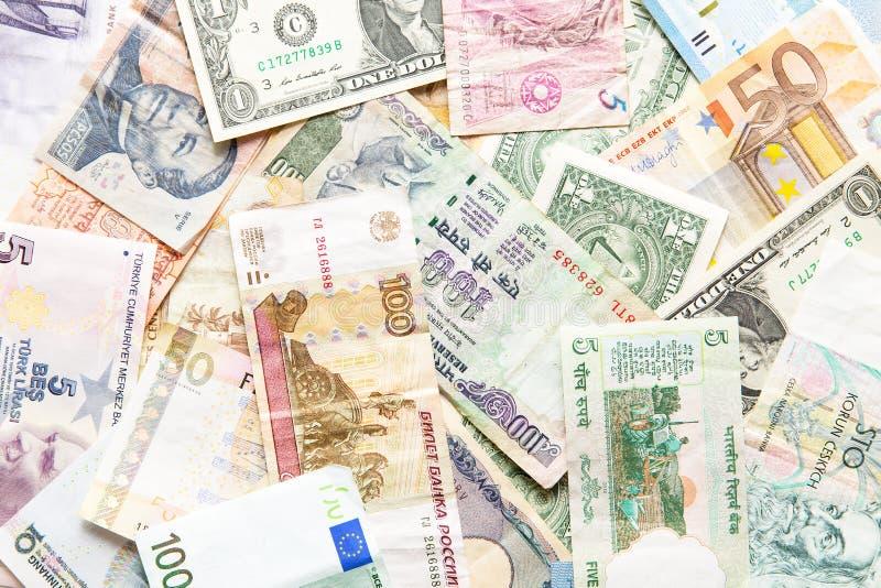 Viele verschiedenen Währungen als Hintergrund stockbilder