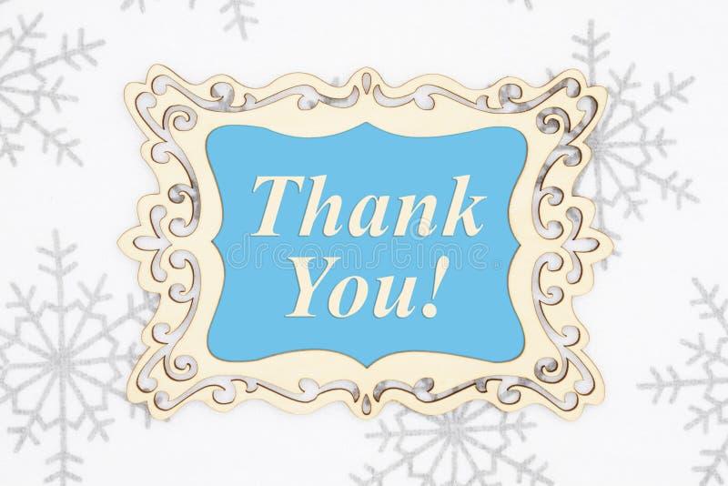 Vielen Dank für Ihre Nachricht in einem Holzrahmen mit Schneeflocken stockbild