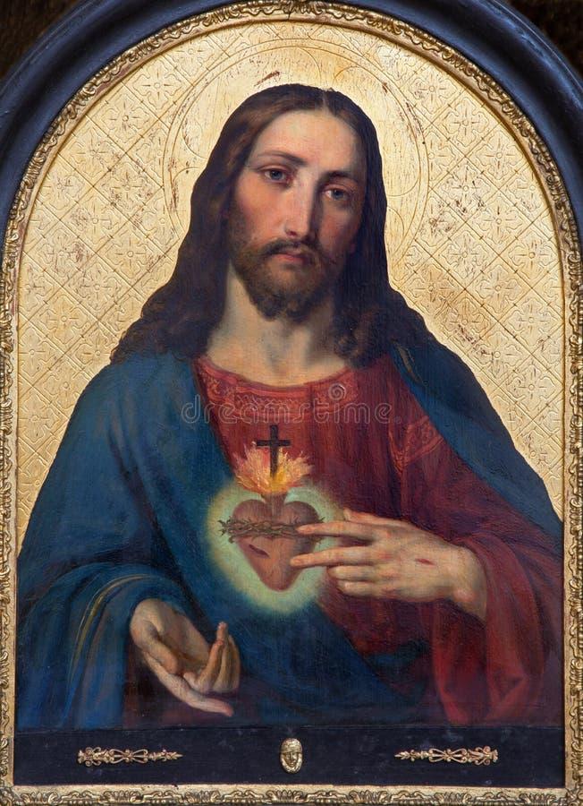 Viena - coração da pintura de Jesus do altar lateral da igreja barroco Maria Treu fotos de stock royalty free