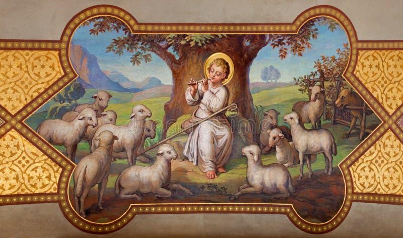 Vienna - affresco di piccolo Gesù come buon pastore da Josef Kastner 1906 - 1911 nella chiesa delle Carmelitane in Dobling. fotografia stock