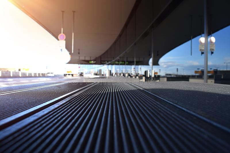 Vienna airport outside bench from interesting perspective by the arriving gate near the taxies. stock images