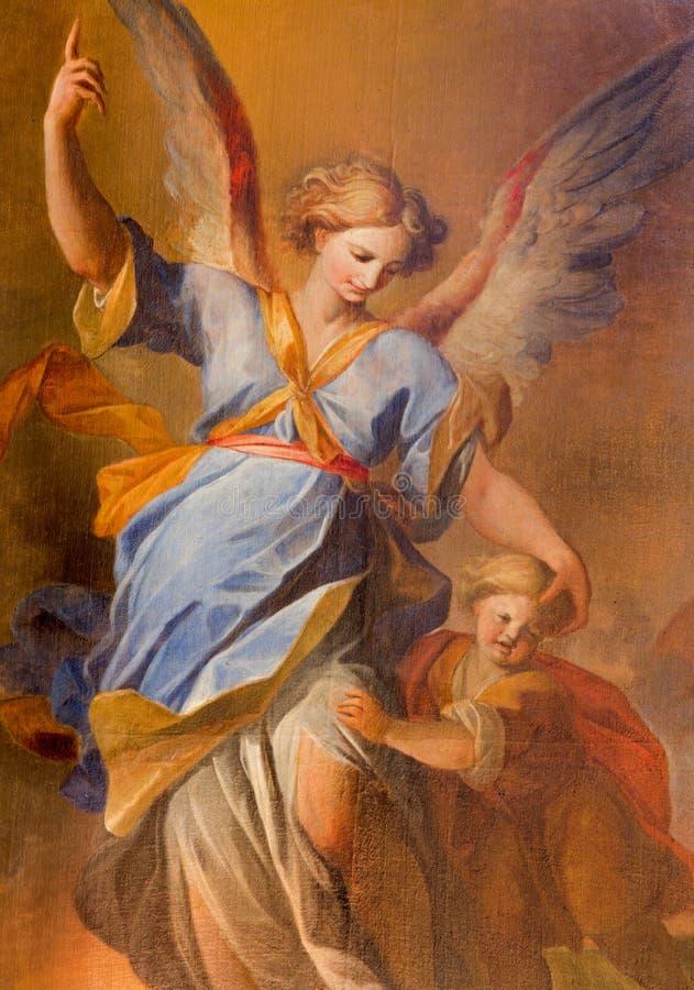 Vienna - angelo custode con la pittura del bambino dall'altare laterale nella chiesa barrocco delle gesuite immagine stock