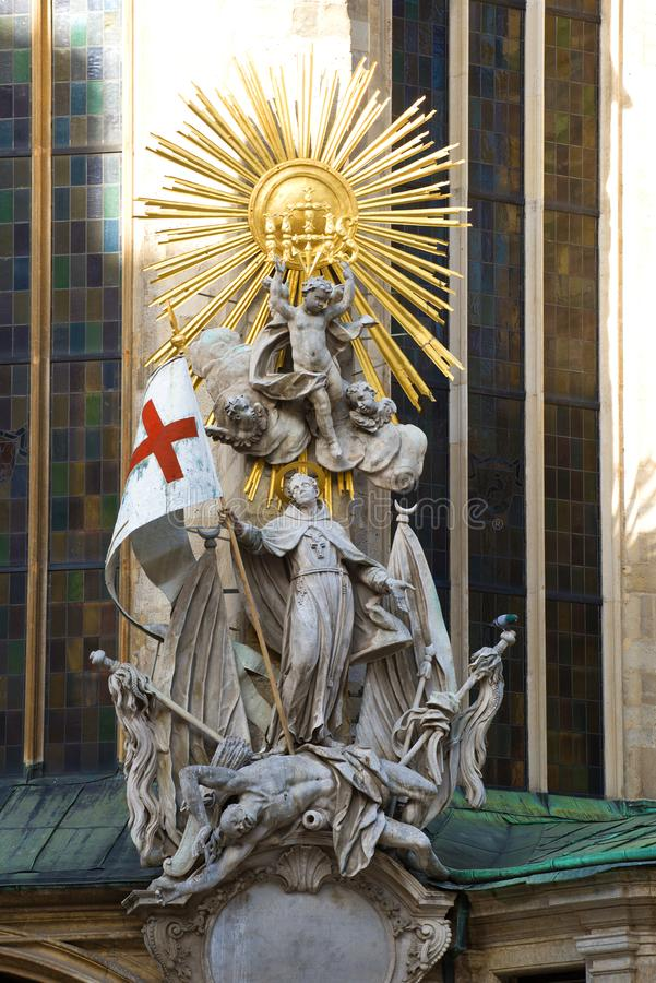 Sculpture of Saint Joahn Capistran conquering the Turks. Detail of the design of the Cathedral of St. Stephen. Vienna, Austria. VIENNA, AUSTRIA - APRIL 25, 2018 royalty free stock photos