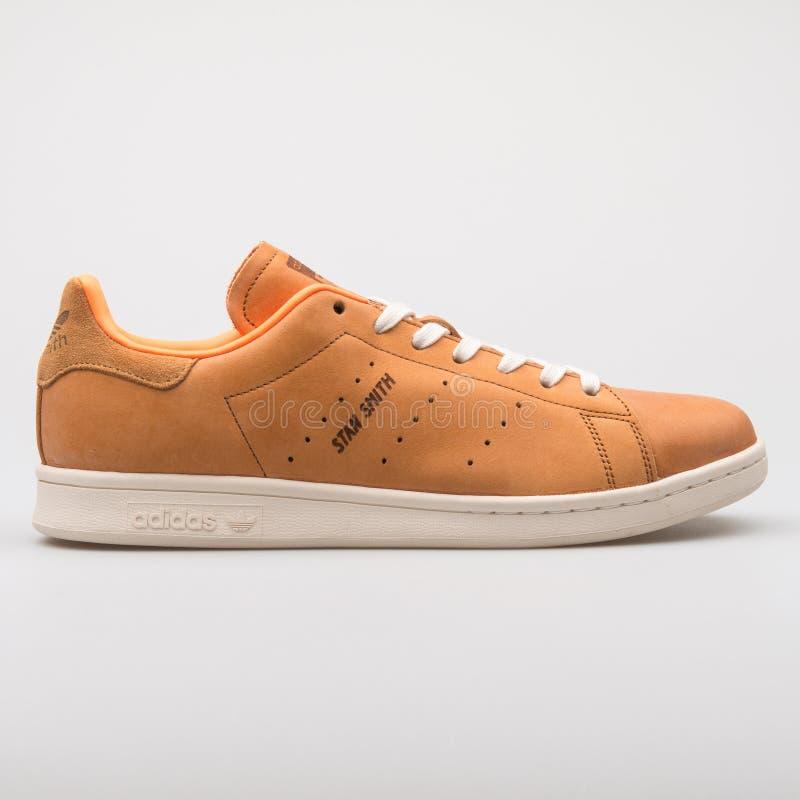 Adidas Stan Smith orange sneaker. VIENNA, AUSTRIA - AUGUST 7, 2017: Adidas Stan Smith orange sneaker on white background stock images