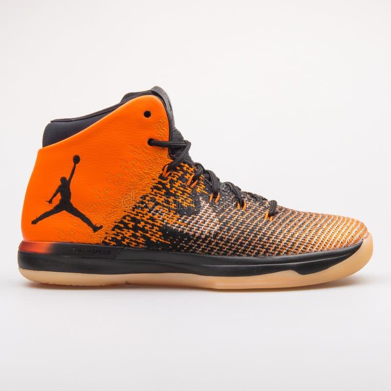 Nike Air Jordan XXXI orange and black sneaker. VIENNA, AUSTRIA - AUGUST 23, 2017: Nike Air Jordan XXXI orange and black sneaker on white background stock photography