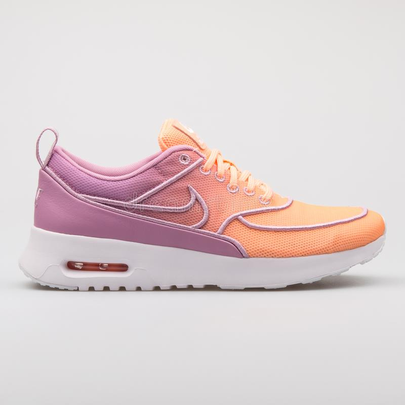 Nike Air Max Thea Ultra SI purple and orange sneaker. VIENNA, AUSTRIA - AUGUST 7, 2017: Nike Air Max Thea Ultra SI purple and orange sneaker on white background royalty free stock photography