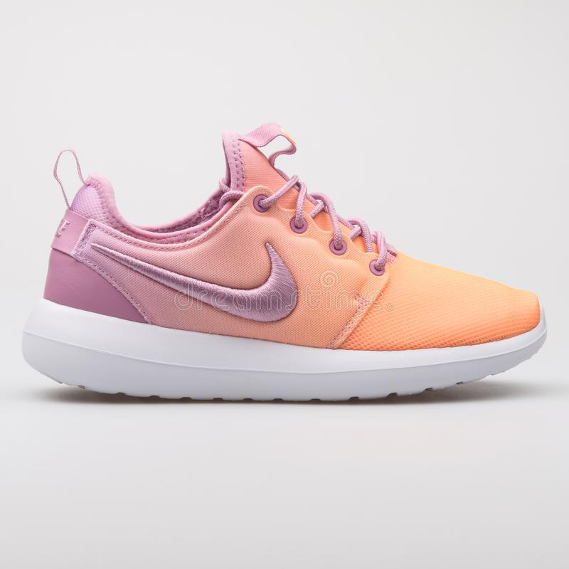 Nike Roshe Two BR purple and orange sneaker. VIENNA, AUSTRIA - AUGUST 7, 2017: Nike Roshe Two BR purple and orange sneaker on white background royalty free stock images
