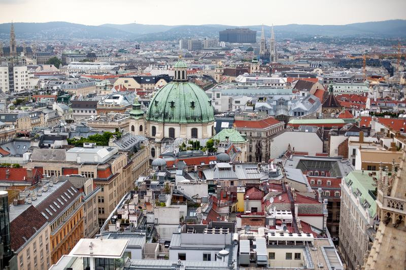 Vienna in Austria, capital city cityscape with rooftop of St. Stephen Cathedral. View on Dome of St. Peter`s Church stock photo