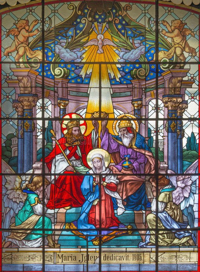 VIENNA, AUSTRIA - DECEMBER 19, 2016: The Coronation of Virgin Mary on the stained glass of church Mariahilfer Kirche. By prof. Rudolf Geyling 1897 in workroom stock images