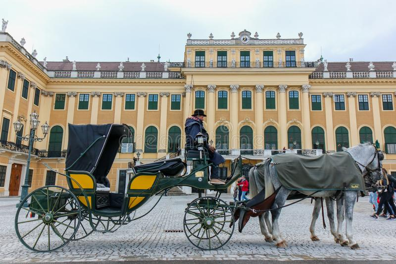 VIENNA, AUSTRIA  - 22-10-2018: Horse - drawn carriage or Fiaker, popular tourist attraction, on Michaelerplatz and Hofburg Palace royalty free stock images