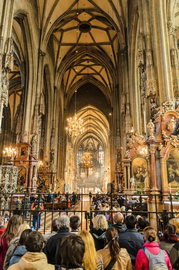 Inside view of Stephansdom St Stephan`s Cathedral. Church full of tourists during a mass. royalty free stock photos