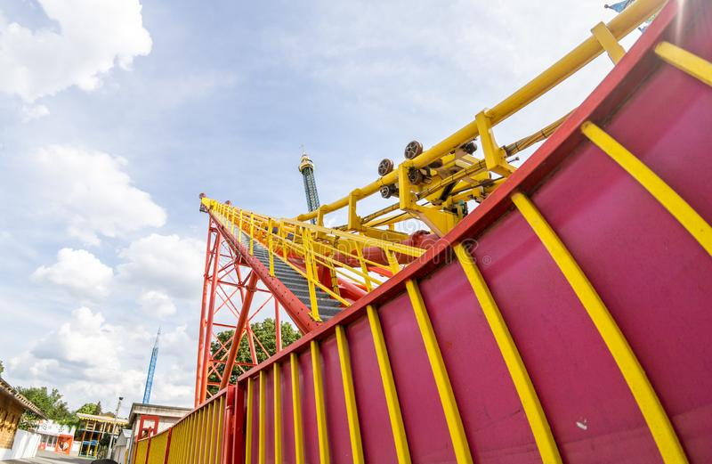 Super wide view of a colorful roller coaster in Prater amusement park at Vienna. Austria royalty free stock photography