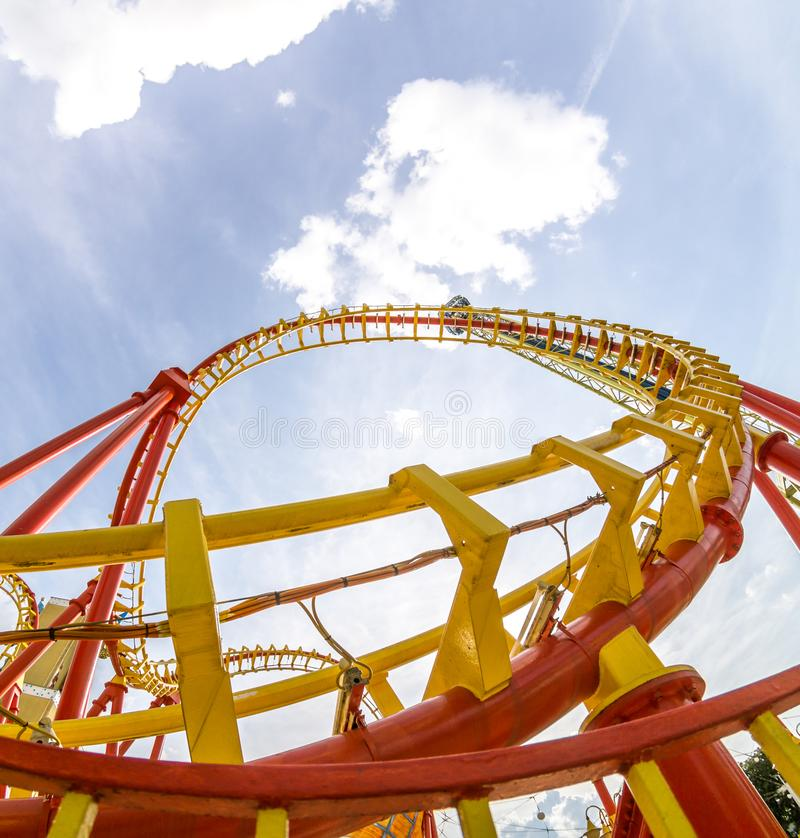 Super wide view of a colorful roller coaster in Prater amusement park at Vienna. Austria royalty free stock photo