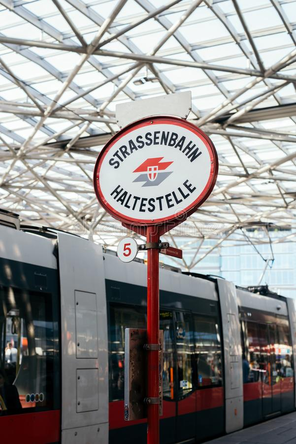 VIENNA, AUSTRIA - SEPTEMBER 19, 2019: Bus and tram stop sign on city background royalty free stock photo