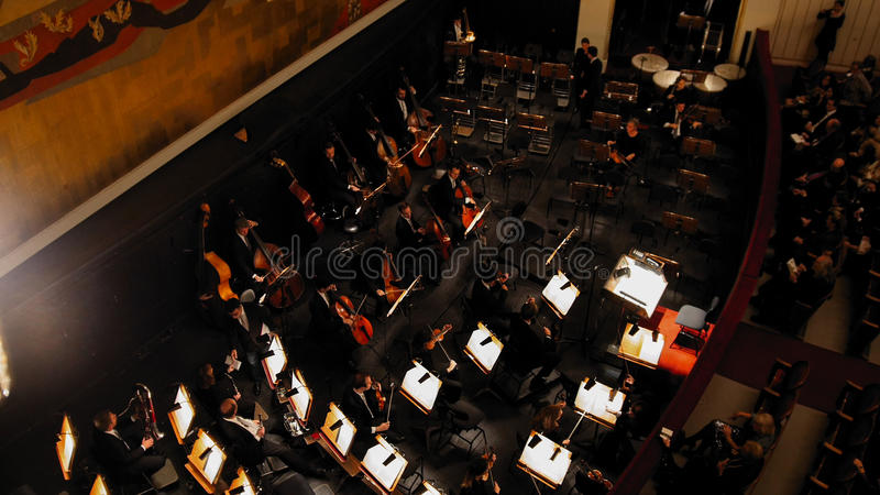 Vienna, AUSTRIA - 13 oct 2016: Opera - Giacomo Puccinis Tosca. the orchestra before the performance. Wide angle royalty free stock photography
