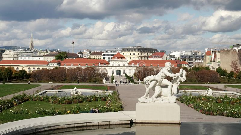 VIENNA, AUSTRIA-OCTOBER, 9, 2017: a fountain with lower belvedere palace in the distance at vienna royalty free stock image