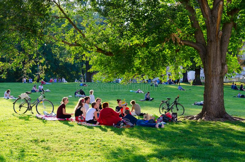 Young people are relaxing in Burggarten park on sunny September day, Vienna, Austria royalty free stock image