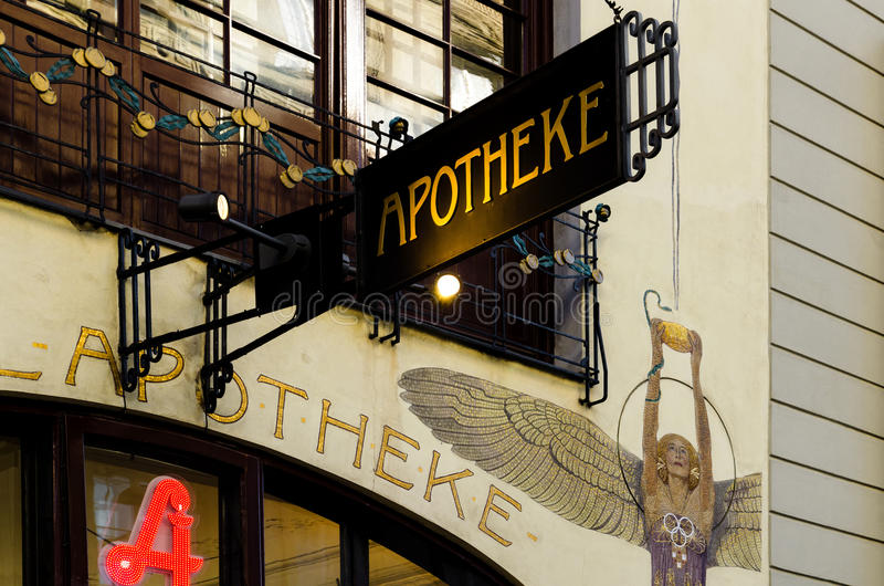 Vienna, Engel Apotheke. VIENNA, AUSTRIA - MAY 18, 2017: Facade and signboard of the famous Engel Apotheke, old chemist store with art nouveau decoration in royalty free stock images