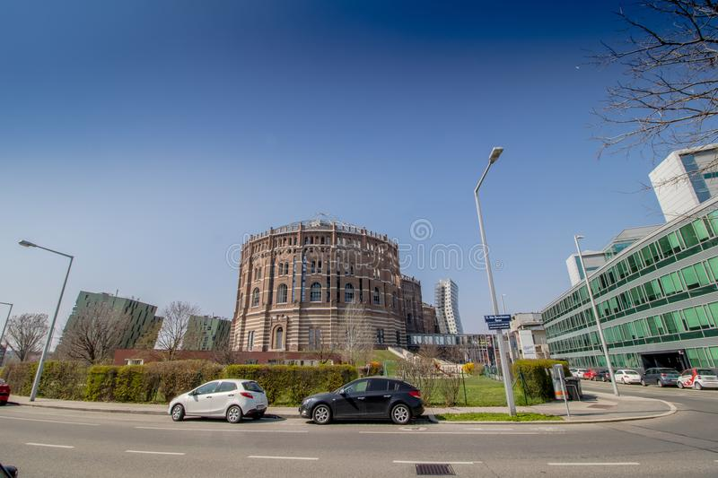 The Vienna Gasometer on sunny day in Vienna, Austria. The gasometers in Vienna-Simmering are four former gas tanks preserved in the facade. They have been stock images