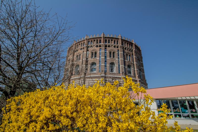 The Vienna Gasometer on sunny day in Vienna, Austria. The gasometers in Vienna-Simmering are four former gas tanks preserved in the facade. They have been stock photos