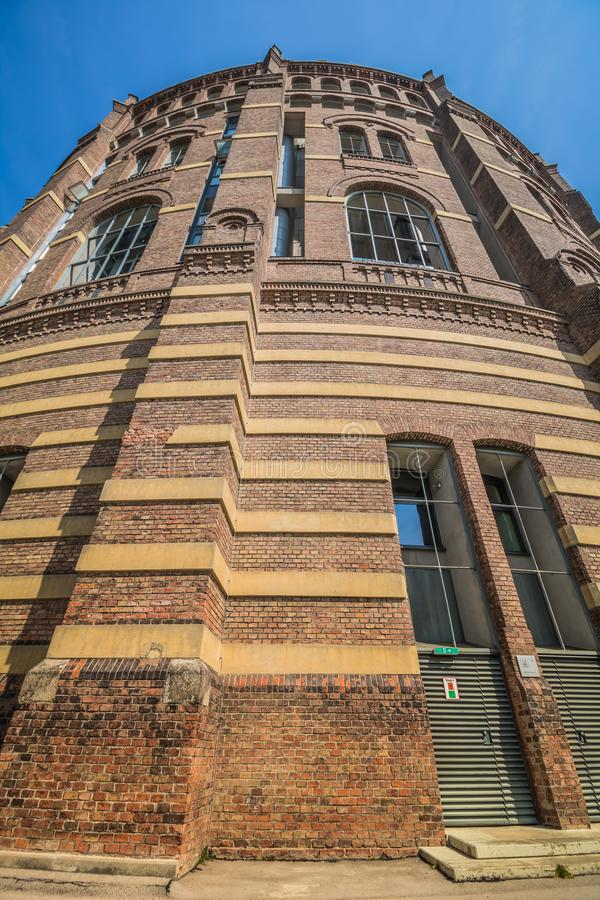 The Vienna Gasometer on sunny day in Vienna, Austria. The gasometers in Vienna-Simmering are four former gas tanks preserved in the facade. They have been royalty free stock photo
