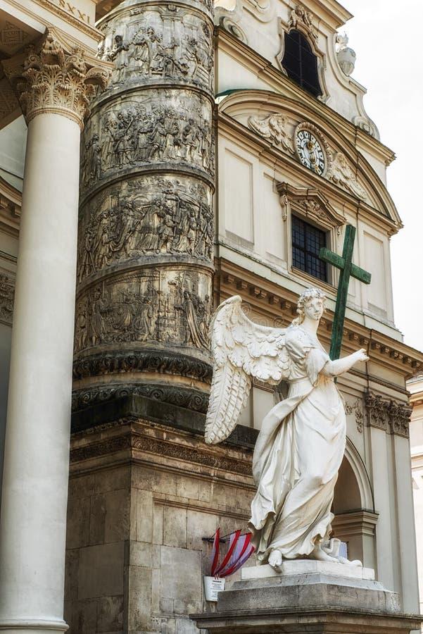 Vienna, Karlskirche entrance statue. Vienna, Austria: Karlskirche. Sculpture of angel stock image