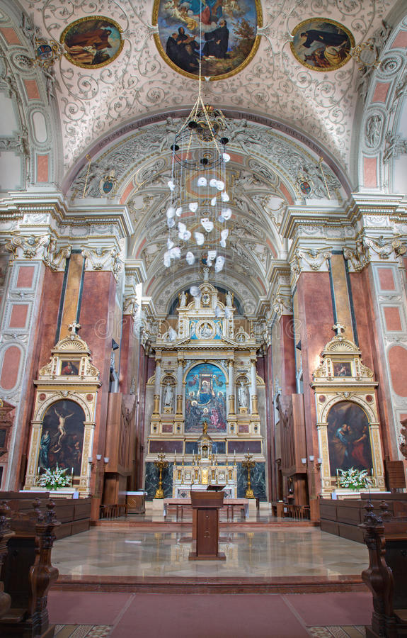 Vienna - Main altar of Schottenkirche. By Heinrich Ferstel with glass mosaic Madonna by Michael Riese on July 3, 2013 Vienna royalty free stock photos