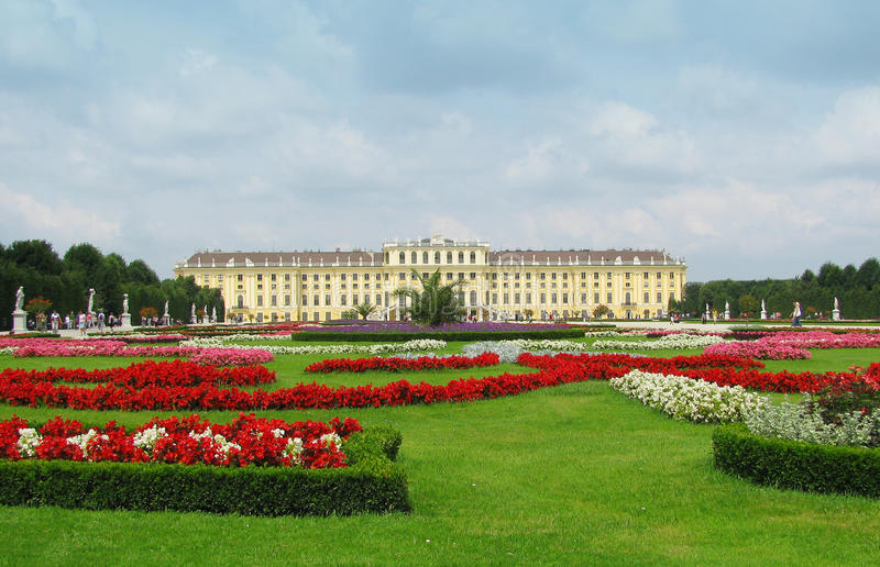 Vienna schonbrunn castle gardens. Wide view of schonbrunn castle and mansion in vienna, austria, with gardens and flowers royalty free stock photo