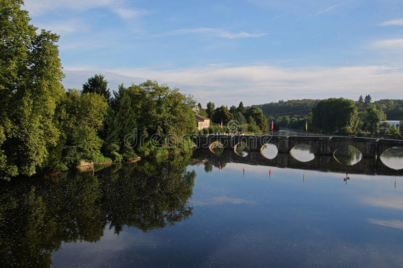 Vienne river, View of medieval bridge Confolens, France. Early morning on the Vienne river, View of medieval bridge Confolens, Poitou Charente, France royalty free stock photography