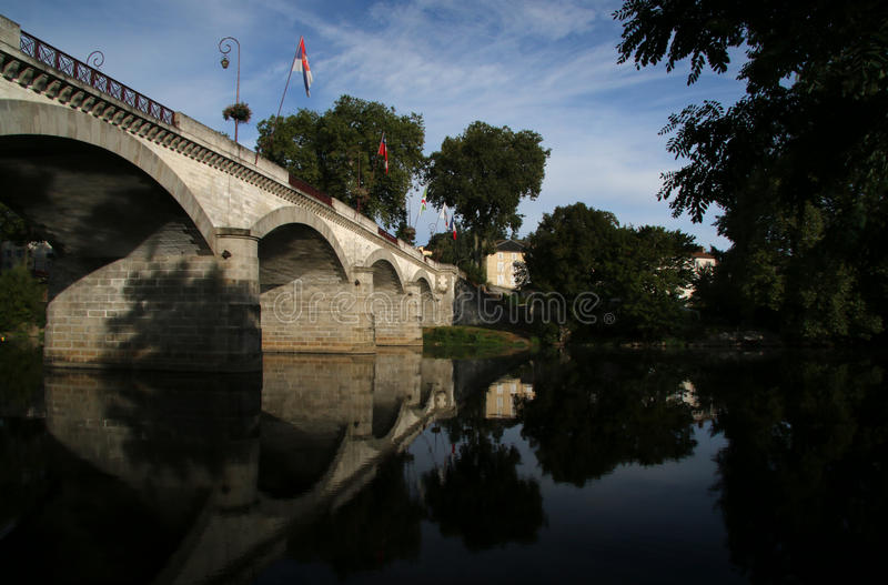 Vienne river, View of medieval bridge Confolens, France. Early morning on the Vienne river, View of medieval bridge Confolens, Poitou Charente, France stock photography