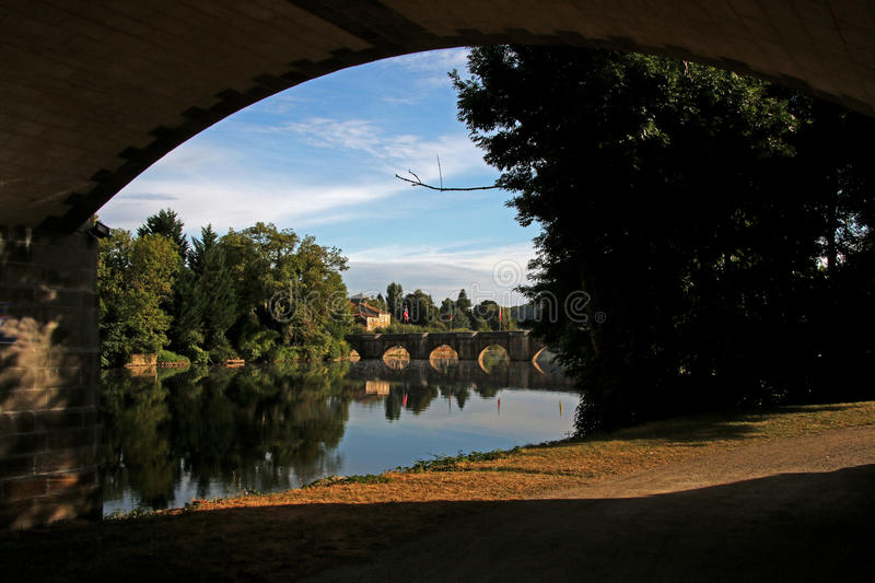 Vienne river, View of medieval bridge Confolens, France. Early morning on the Vienne river, View of medieval bridge Confolens, Poitou Charente, France stock photos